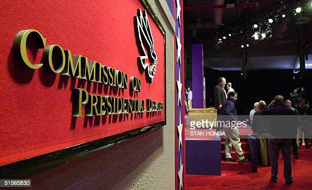 The Commission of Presidential Debate sign is seen in the foreground as workers prepare the stage at the University of Massachusetts in Boston 02...