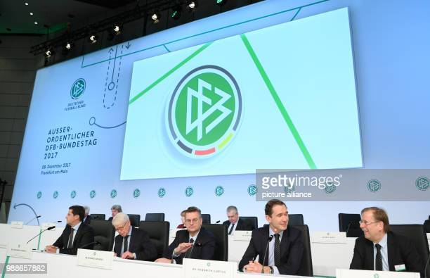 The committee of the German Football Association sits on stage at the extraordinary federal conference of the German Football Association  in...