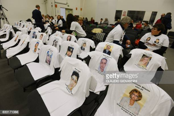 The committee of victims set teeshirts showing portraits of relatives on the chairs in the courtroom before to hear the sentence in the trial of the...