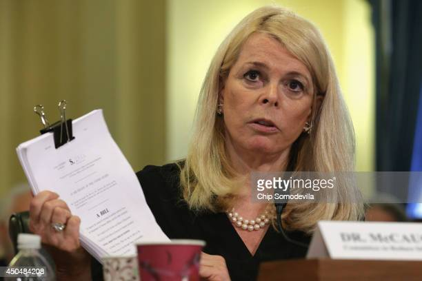 The Committee to Reduce Infection Deaths Chairman Betsy McCaughey holds up a copy of proposed legislation while testifying before the House Veterans'...