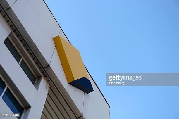 The Commonwealth Bank of Australia logo is displayed atop a bank branch in Melbourne Australia on Friday May 1 2015 Commonwealth Bank is the nation's...