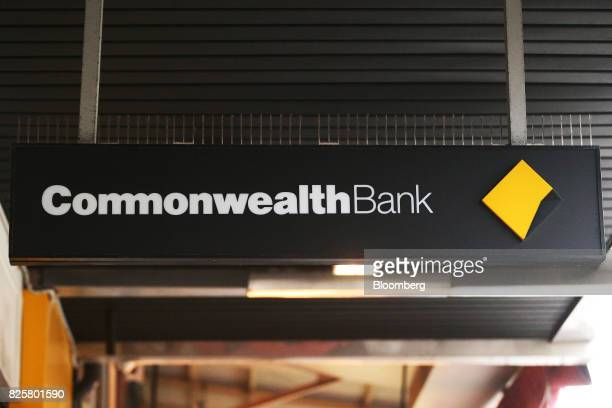 The Commonwealth Bank of Australia logo is displayed on a sign outside a branch in Sydney Australia on Thursday Aug 3 2017 Commonwealth Bank...