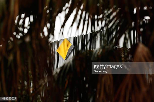 The Commonwealth Bank of Australia logo is seen through foliage outside one of the bank's branches in Sydney Australia on Monday Feb 10 2014...