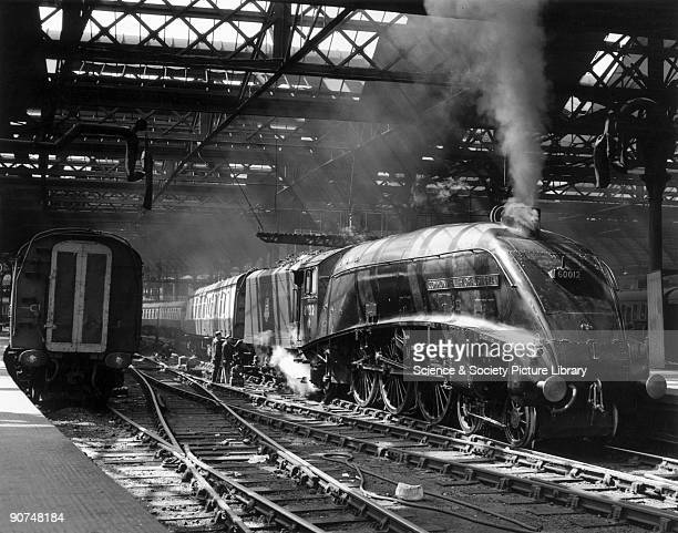 The Commonwealth of Australia A4 Class steam locomotive No 60012 backing on to an express train at Newcastle Station Tyne Wear Photograph by Bishop...