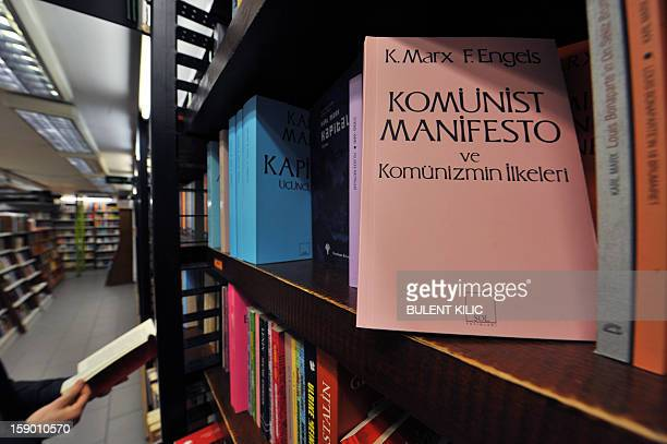 The Communist Manifesto, a publication written by the political theorists Karl Marx and Friedrich Engels is pictured in a bookstore on January 5 in...