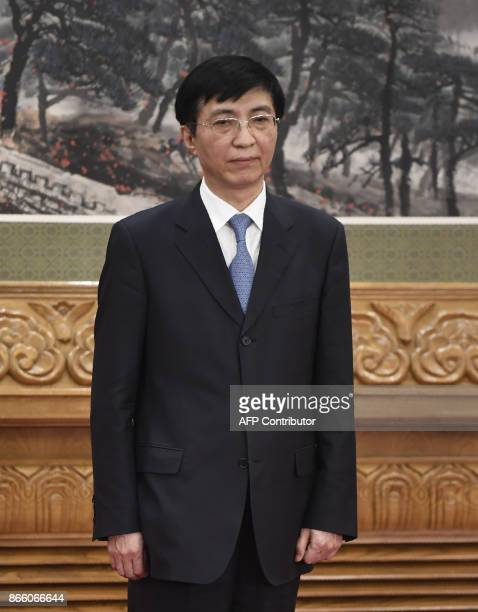 The Communist Party of China's new Politburo Standing Committee the nation's top decisionmaking body Wang Huning meets the press at the Great Hall of...