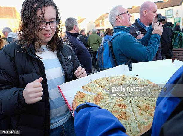 The community comes together as a local pizza shop hands out free pizza ahead of a torchlit procession to the top of the Eston Hills on October 24...