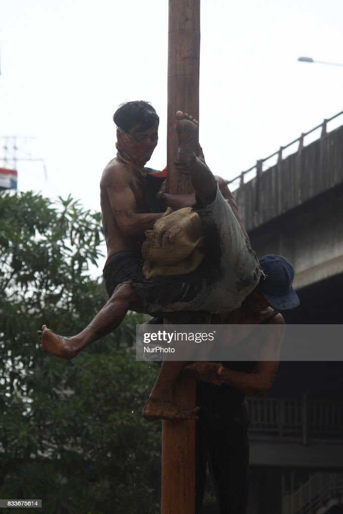 The community is excited to participate in the 'Panjat Pinang' (Areca Pool Climbing), to commemorate Indonesia's 72nd Independence Day in Jakarta, August 17, 2017. 'Panjat Pinang' race is one of the typical race for Indonesian community in commemorating the day of Independence. This race is considered as a representation of hero's attitude that upholds unity, solidarity, and never give up in fighting for Independence.
