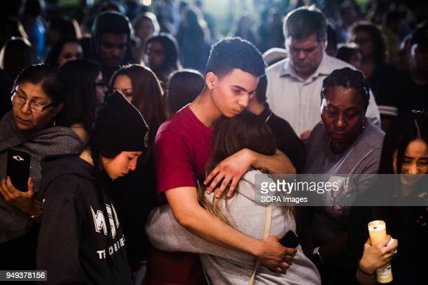 The community of Parkland came together for a candlelight vigil to mourn the loss of the 17 lives that were lost in the school shooting at Marjory...