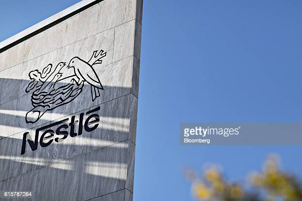 The company birds nest logo sits carved in stone on an exterior wall outside the Nestle SA headquarters in Vevey Switzerland on Thursday Oct 20 2016...