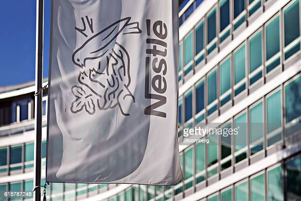 The company birds nest logo sits on a flag outside the Nestle SA headquarters in Vevey Switzerland on Thursday Oct 20 2016 Nestle cut its fullyear...