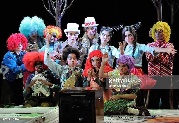The Company Garsington Opera Young Artists programme perform in 'Hansel and Gretel' at West Green on July 24 2014 in Hook Hampshire