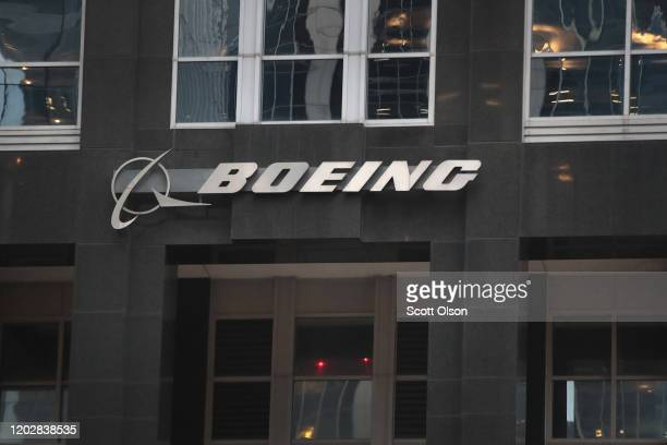 The company logo hangs above an entrance to the headquarters of The Boeing Company on January 29, 2020 in Chicago, Illinois. Boeing said today that...