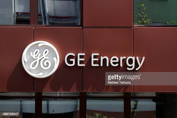 The company logo of engineering company General Electric hangs on the wall of the building on May 5, 2014 in Belfort, France. General Electric is...