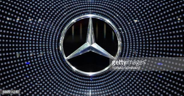 The company logo of German carmaker Daimler and MercedesBenz is pictured before the annual shareholders meeting in Berlin on March 29 2017 / AFP...