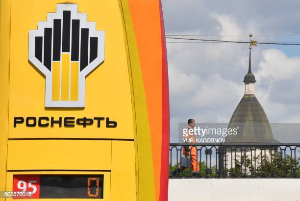 The company logo of Russia's state oil giant Rosneft is seen at a petrol station in Moscow on June 28 2017 A wave of cyberattacks hit Russia and...
