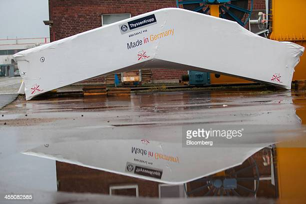 The company logo sits above the wording Made In Germany on protective wrapping covering a completed escalator before shipping at the ThyssenKrupp AG...