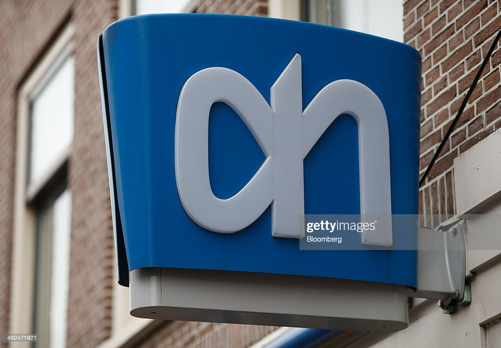 The company logo sits on a sign outside an Albert Heijn supermarket, operated by Koninklijke Ahold NV, in Utrecht, Netherlands, on Friday, Nov. 29, 2013. European government bonds were little changed as investors showed a muted reaction to Standard & Poor's decision to raise its outlook on Spain's debt and strip the Netherlands of its top credit rating. Photographer: Jasper Juinen/Bloomberg via Getty Images