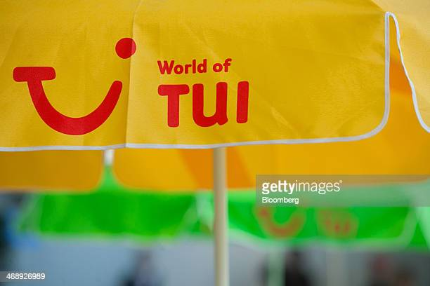The company logo sits on a sun parasol before TUI AG announces their full-year earnings in Hanover, Germany, on Wednesday, Feb. 12, 2014. TUI AG, the...