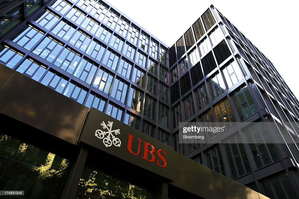 The company logo sits on display outside the offices of UBS AG in Basel, Switzerland, on Tuesday, July 23, 2013. Europe's biggest banks, which more than doubled their highest-quality capital to $1 trillion since 2007 to meet tougher rules, may have further to go as regulators scrutinize how lenders judge the riskiness of their assets. Photographer: Gianluca Colla/Bloomberg via Getty Images
