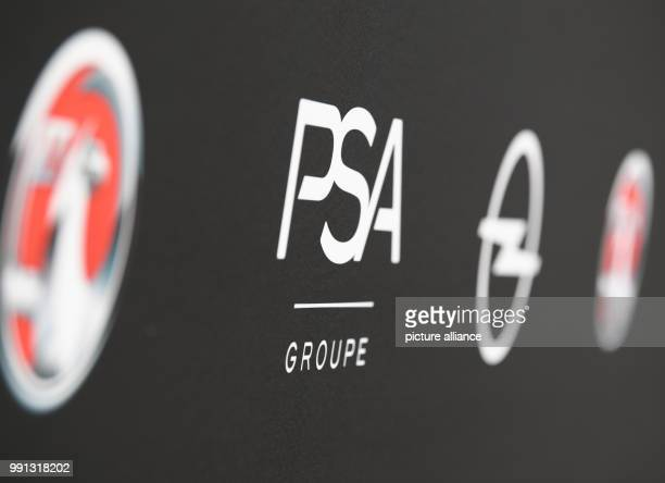 The company logos of Opel PSA and Vauxhall are shown at the Opel Design Center in Ruesselsheim Germany 9 November 2017 Car maker Opel is presenting...