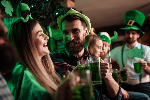 The company of young people celebrate St. Patrick's Day. 905932838