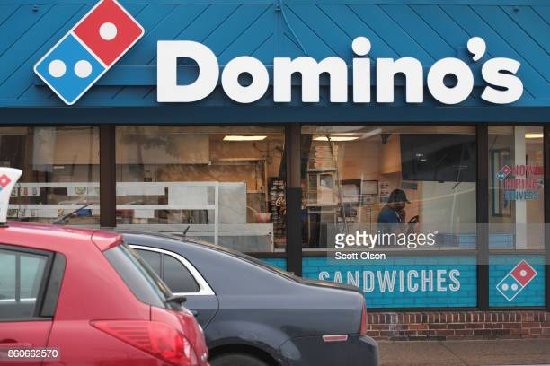 The company's logo across the front of an awning marks the location of a Domino's restaurant on October 12 2017 in Chicago Illinois Shares of the...