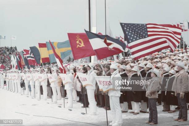 The competing nations Olympic flag bearers arrive at the Opening Ceremony for the XIII Olympic Winter Games on 14 February 1980 at the Lake Placid...