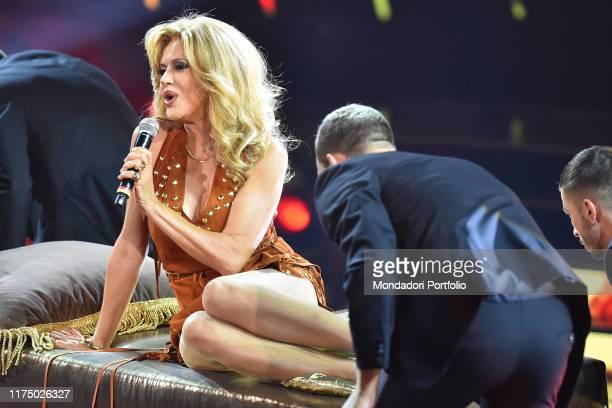 The competitor Eva Grimaldi imitates the singer Amanda Lear during the first episode of the broadcast Tale e Quale Show at the RAI studios Fabrizio...