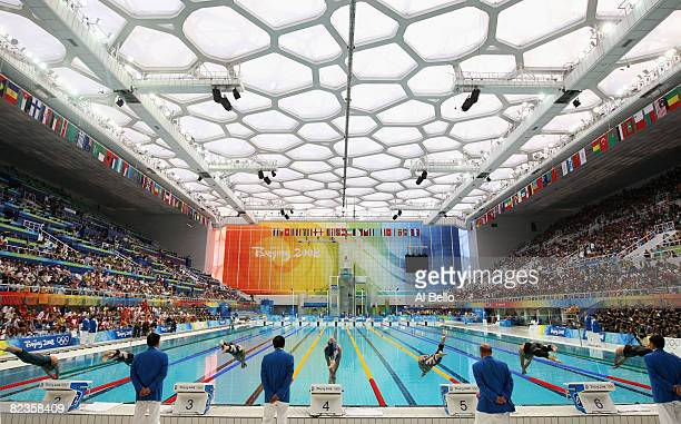 The competitors dive into the water at the start of the second Men's 50m Freestyle Semifinal held at the National Aquatics Centre during Day 7 of the...
