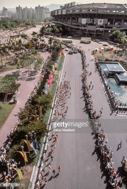 The competitors in the 1988 Olympics Men's Marathon exit the Jamsil Olympic Stadium to begin the race on October 2, 1988 in Seoul, South Korea.
