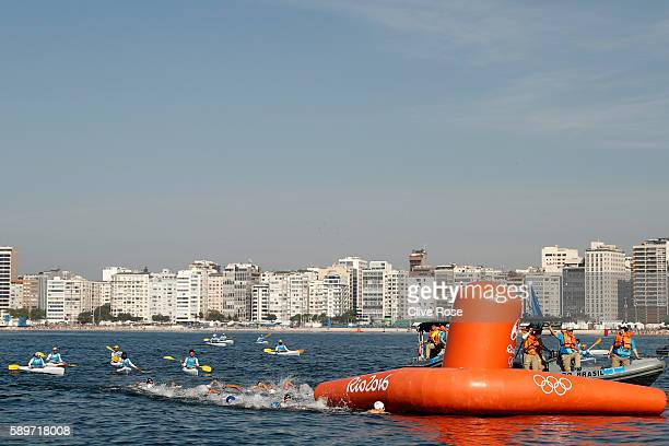 The competitors swim in the Women's 10km Marathon Swimming on day 10 of the Rio 2016 Olympic Games at Fort Copacabana on August 15 2016 in Rio de...