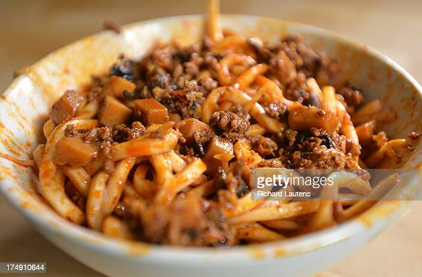 TORONTO ON JULY 27 The completed and mixed Dan Dan Noodles Feast with Corey Mintz has Corey and guest helper Jennifer Yang making Dan Dan Noodles The...