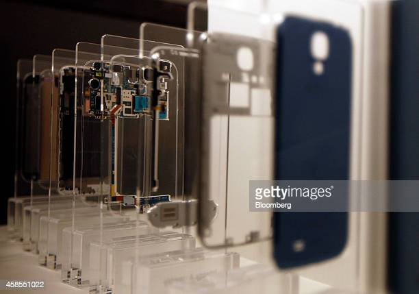 The components of a disassembled Samsung Galaxy S4 smartphone stand on display in an exhibition hall at the Samsung Innovation Museum operated by...