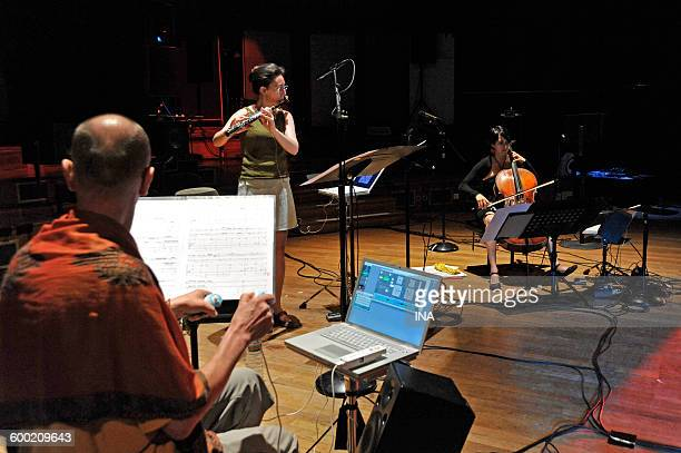 The composer Francis Faber with the flutist Anne Cartel and the violoncellist Martina Rodriguez on stage during Live Electronic du GRM