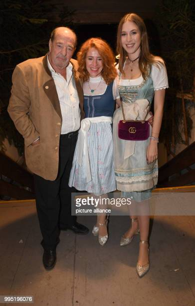 The composer Ralph Siegel his partner Laura Kaefer and his daughter Alana Siegel can be seen at the Bavarian Oktoberfest in Munich Germany 23...