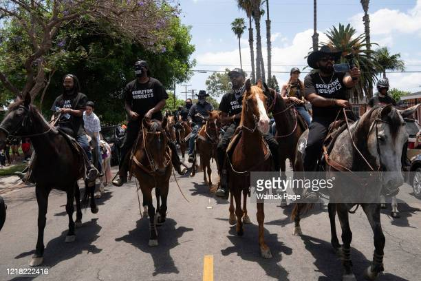 The Compton Cowboys participate in a 'peace ride' for George Floyd on June 7, 2020 in Compton, California. This is the 13th day of protests since...