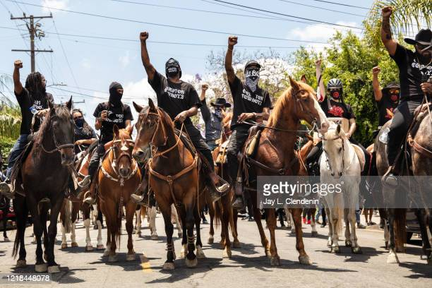 The Compton Cowboys ride down S Tamarind Ave, along with a couple thousand protesters, during the Compton, CA, Peace Ride, culminating at City Hall,...