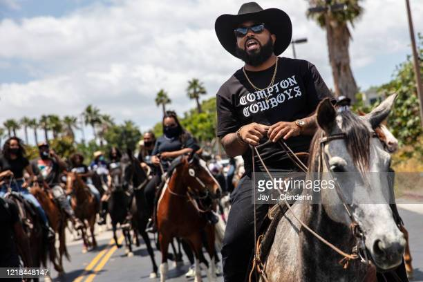 The Compton Cowboys, with Randy Savvy riding lead, prepare to leave Gateway Towne Center, for the start of their Peace Ride, culminating at Compton...