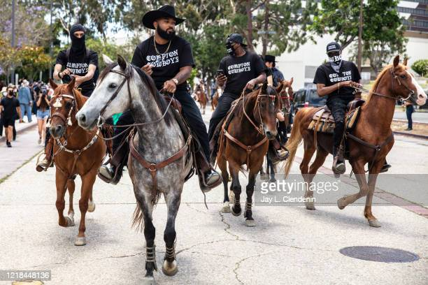 The Compton Cowboys with Randy Savvy riding lead second from left arrive at Gateway Towne Center for the start of their Peace Ride culminating at...