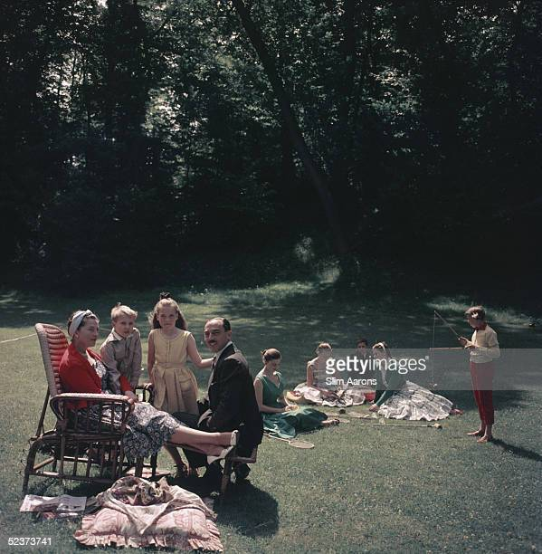 The Comte de Paris pretender to the French throne with his wife the Comtesse and their children in the garden of their home the Manoir du Coeur...