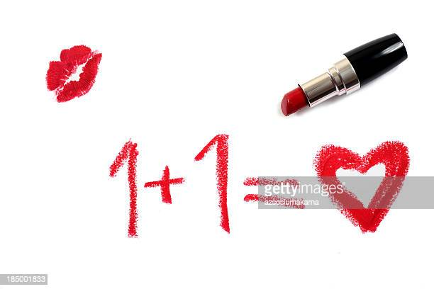 the concept of love written in pink lipstick with a kiss - lipstick stock pictures, royalty-free photos & images