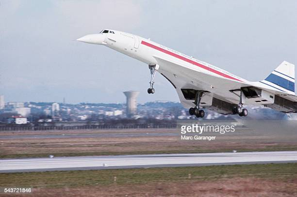 The Concorde takes off from a runway for its first flight.
