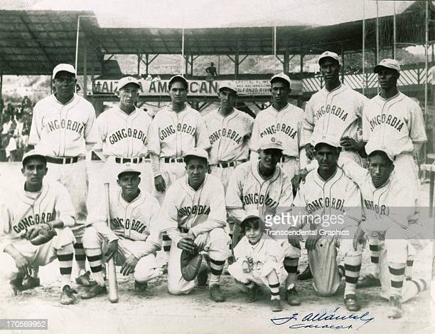 The Concordia Baseball Team poses for the annual portrait in 1933 in the ball park in Caracas, Venezuela. Hall of Fame star Martin Dihigo stands far...