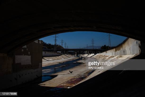 The concrete banks of the Los Angeles River is seen under the bridge of North Spring Street in Los Angeles California on May 25 2020 On May 22 2020 a...