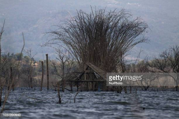 The condition of destroyed houses was seen when the water in Jatigede reservoir shrank in Cipaku village Sumedang regency West java province on...
