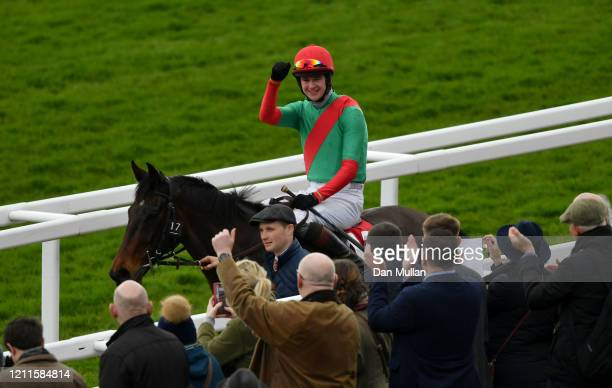 The Conditional ridden by Brendan Powell celebrate winning the Ultima Handicap Chase at Cheltenham Racecourse on March 10, 2020 in Cheltenham,...