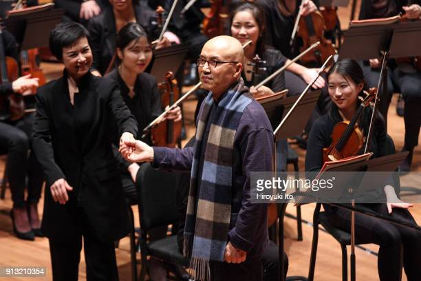 The conductor Chen Lin left and the composer Chen Qigang with the Juilliard Orchestra after Chen Lin conducted Chen Qigang's 'Luan Tan' at Alice...