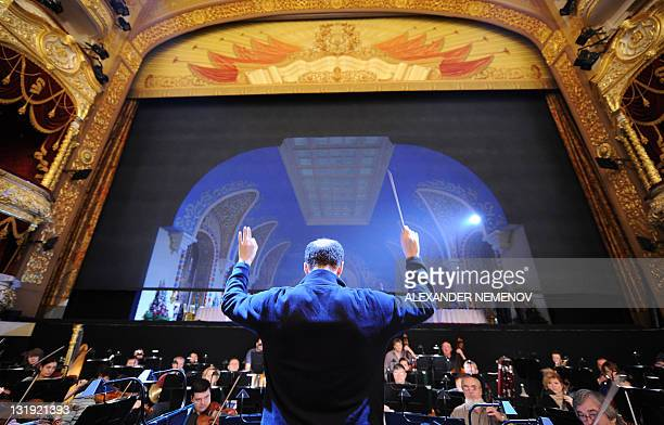 The conductor's assistant guides the orchestra during sound check before a dress rehearsal of 'Ruslan and Lyudmila' by Russian composer Mikhail...