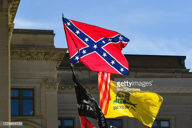 The confederate flag flies at a Stop The Steal rally in front of the Georgia State Capitol Building on November 28th, 2020 in Atlanta, GA.